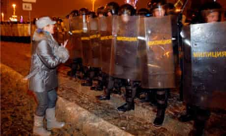 opposition suppoter appeals to riot police