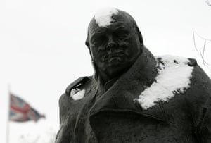 snow continues in uk: Snow on the statue of Winston Churchill in Parliament Square