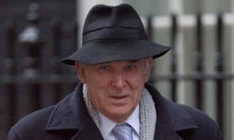 Vince Cable arrives at 10 Downing Street for a cabinet meeting on 21 December 2010.