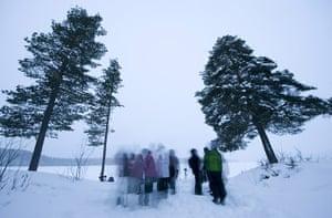 Lunar Eclipse: People wait for the Lunar eclipse near the village of Vuollerim
