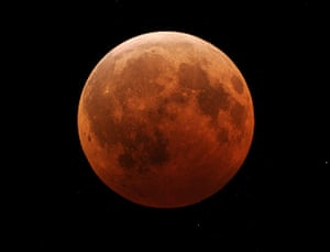 Lunar Eclipse: The Moon is engulfed in the Earth's shadow during the winter solstice