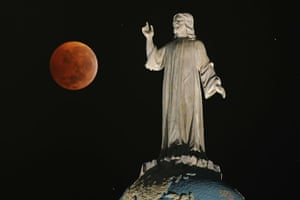 Lunar Eclipse: A double expousure picture shows the moon and The Savior of The World