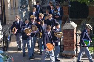 School Uniforms: A group of boys in formal school uniform exit school gates