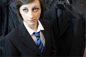 School Uniforms: A girl looks up wearing a smart school tie and blazer