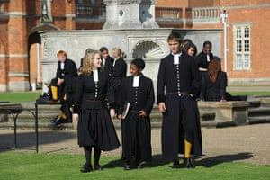 School Uniforms: Students outside a tudor building wearing traditional tudor uniform