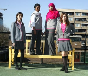 School Uniforms: A group of teenage schoolgirls model a modern grey & pink uniform