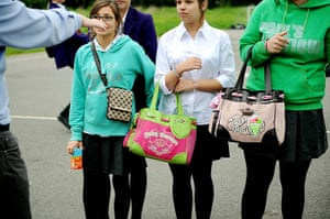 School Uniforms: Three schoolgirls not in uniform carry their fashionable bags