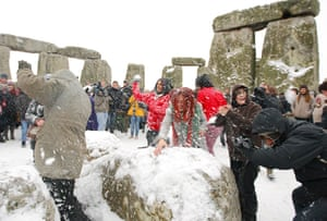Winter Solstice: People snowball fight during the winter solstice at Stonehenge in Wiltshire