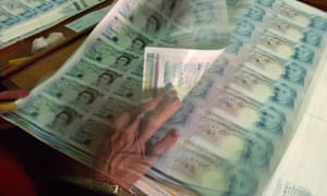 Newly printed sheets of £5 notes at the Bank of England printing works
