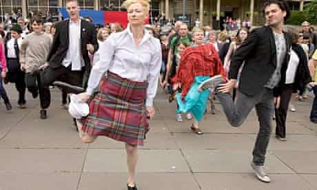 Tilda Swinton and Mark Cousins lead a flashmob dance to a song from Laurel and Hardy's Way Out West