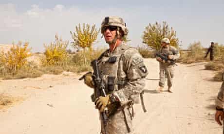 US army captain John Hintz leads his men through a minefield in Talukan in Kandahar province