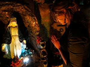 Christian in Middle East: An Iraqi woman prays after a Christmas in Amman