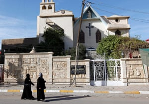 Christian in Middle East: Iraqi women pass by a closed church