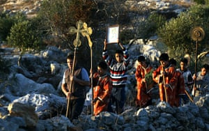 Christian in Middle East: alestinian alter boys parade from the ancient monastery of St. Barbara