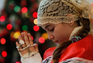 Christian in Middle East: Iraqi Christian girl attends a Christmas mass at Chaldean Catholic church