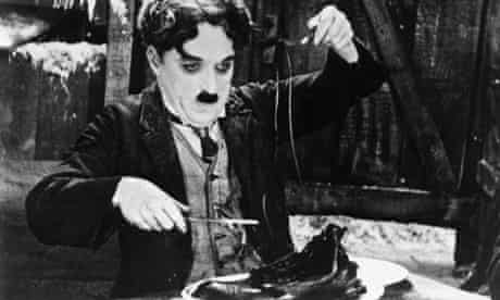 Charlie Chaplin in the Shoe-Eating Scene from <The Gold Rush>.