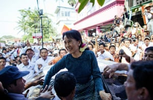 2010: year in pictures: Aung San Suu Kyi greeted by her supporters in Rangoon after being released