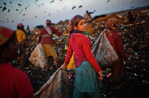 2010: year in pictures: A New Delhi rag-pciker at work on the Ghazipur landfill site