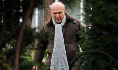 Vince Cable leaves his home in London on 23 December 2010.