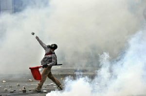2010: year in pictures: A protestor on the attack near the parliament building in Athens