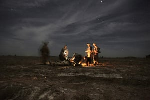 2010: year in pictures: US marines attend a comrade wounded by an IED in Helmand province