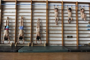 2010: year in pictures: Young gymnasts at a school in Jiaxing, Zhejiang, China