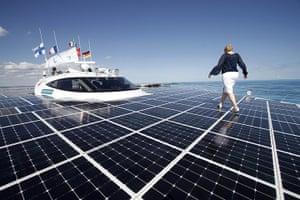 2010 green technologies: A woman walks on the deck of the world's largest solar boat in Cancun