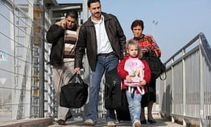 A Palestinian Christian family from Gaza enter Israel to get to Bethlehem for Christmas