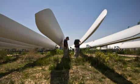 Workers in China painting wind turbine blades