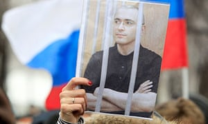 A woman holds a picture of jailed tycoon Mikhail Khodorkovsky at a rally in Moscow