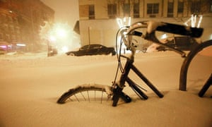 Snow-covered bicycle in New York