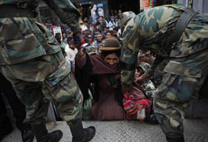 24 hours : El Alto, Bolivia: Soldiers help a woman get into a truck during a strike