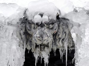 24 hours : Zurich, Switzerland: A fountain sculpture covered with ice