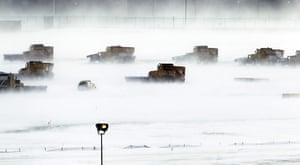 24 hours : Philadelphia, USA: Snow removal crews work to clear runways at the airport