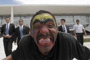 24 hours : Brasilia, Brazil: A resident looks at the camera during a demonstration