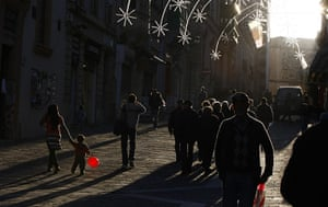 24 hours : Valletta, Malta: A child carries a balloon in the shopping district