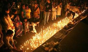 Mumbai residents at a candlelit vigil near the Oberoi hotel