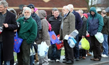 People wait in line at Avoniel Leisure Centre, Belfast, to collect drinking water