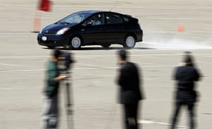 Year in business: A Toyota Prius car is demonstrated breaking at 85 MPH
