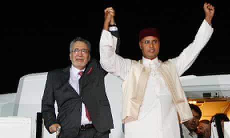 Convicted Lockerbie bomber, Abdel Baset al-Megrahi, with Seif al-Islam Gaddafi on arrival in Libya
