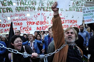 Year in business: Demonstrators shout slogans against government's austerity measures, Greece