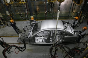 Year in business: Workers assemble a car at the GM Daewoo Vietnam automaker plant in Hanoi