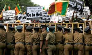 Supporters of Sri Lanka's ruling coalition protest outside the British embassy in Colombo