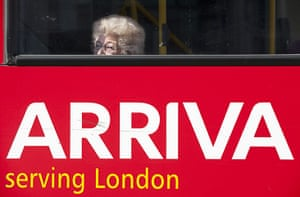 Year in business: A passenger looks from the window of an Arriva Plc bus