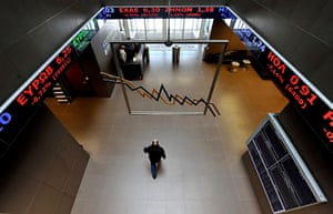 Year in business: An employee walks in the Athens stock exchange