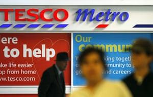 Year in business: People walk past a Tesco metro supermarket in London