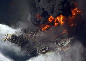 Year in business: Deepwater Horizon oil rig is seen burning