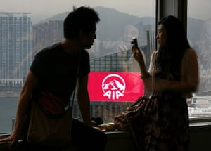 Year in business: A couple in the Bank of China Tower near AIA Central building in Hong Kong
