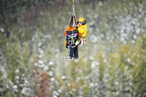 24 hours in pictures: Rescue workers evacute British skier Chemmy Alcott