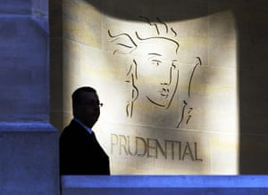 Year in business: A security guard is silhouetted in front a Prudential office in London